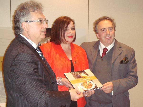 'Breaking Bread in L'Aquila' author Maria Filice, center, pauses for a photo at the book launch.